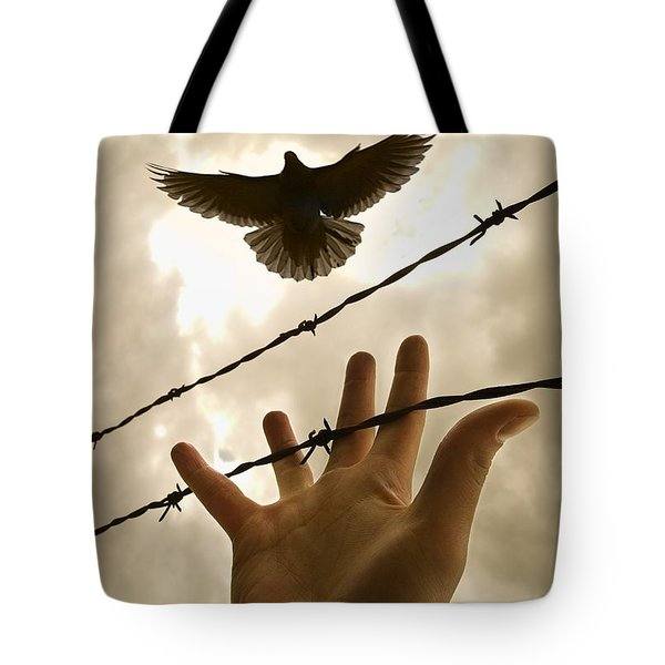 Hand Reaching Out For Bird Tote Bag by Nathan Lau