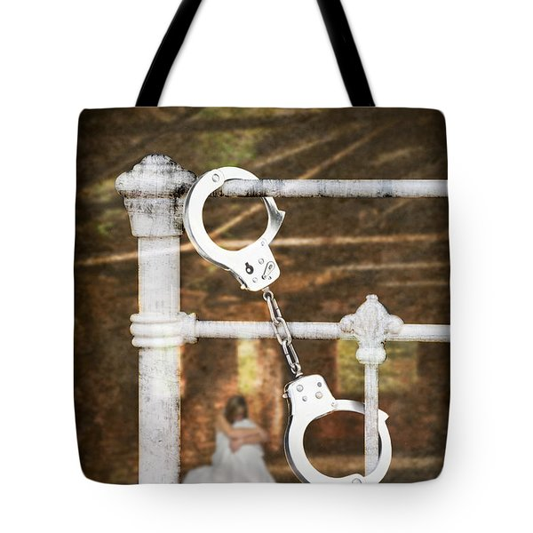 Handcuffs On Bed Tote Bag by Amanda And Christopher Elwell