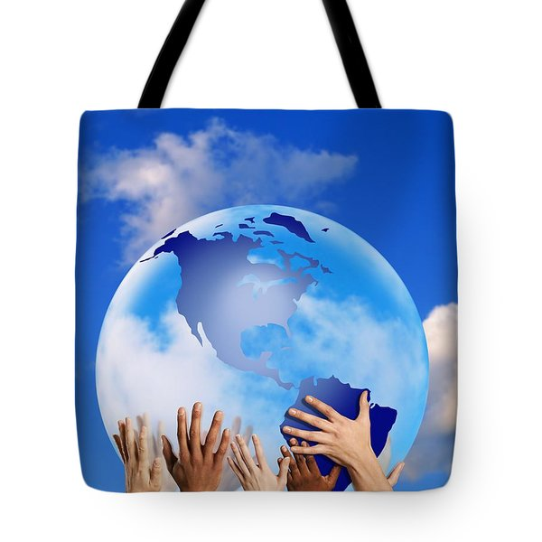 Hands Touching A Globe Tote Bag by Don Hammond