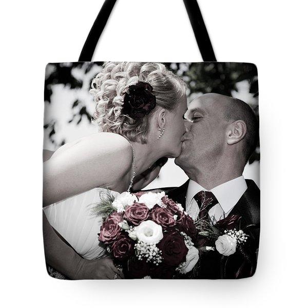 Happy Bride And Groom Kissing Tote Bag by Michal Bednarek