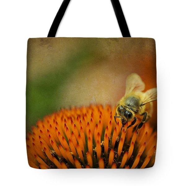 Honey bee on flower Tote Bag by Dan Friend