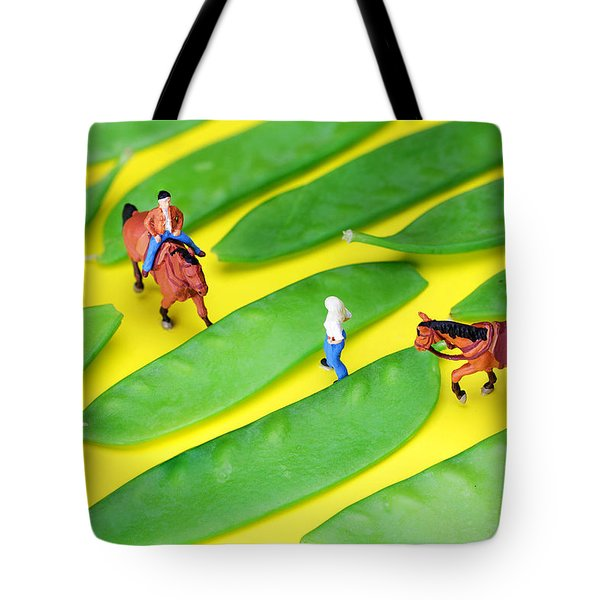 Horse riding on snow peas little people on food Tote Bag by Paul Ge