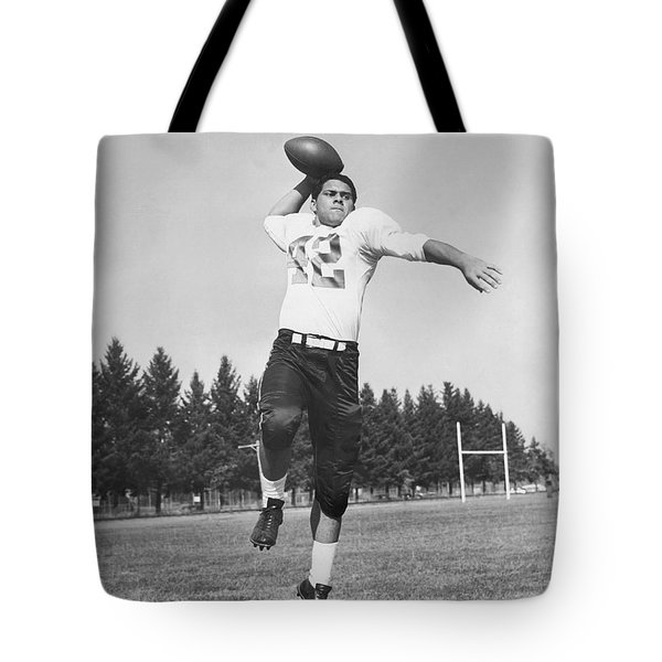 Joe Francis Throwing Football Tote Bag by Underwood Archives