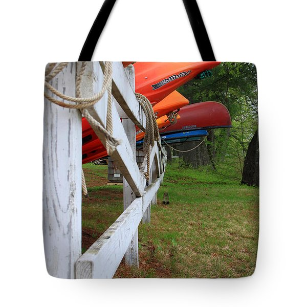 Kayaks On A Fence Tote Bag by Michael Mooney