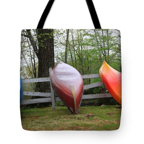 Kayaks on fence 2 Tote Bag by Michael Mooney