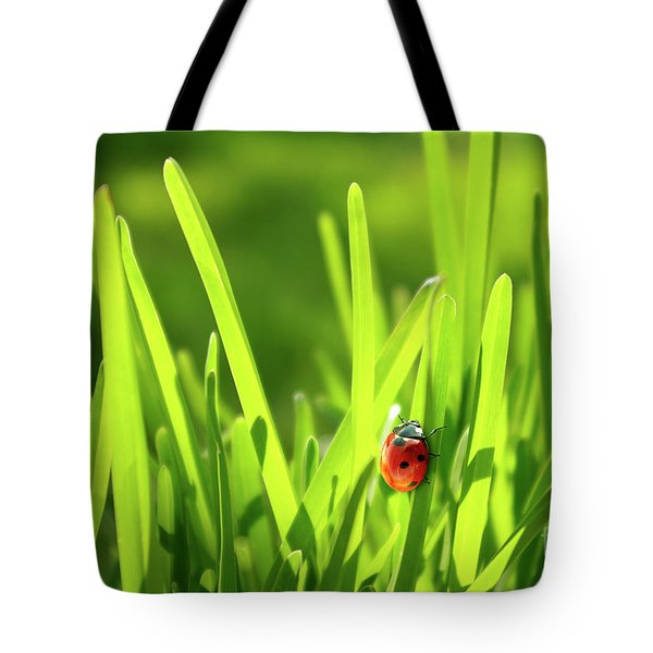 Ladybug In Grass Tote Bag by Carlos Caetano