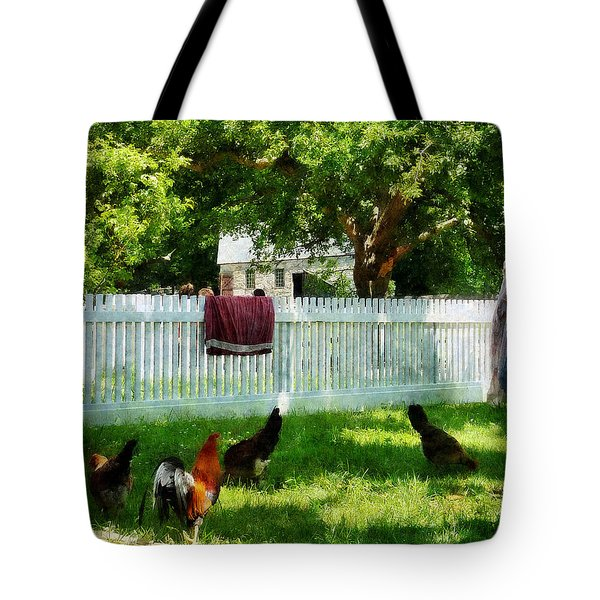 Laundry Hanging On Fence Tote Bag by Susan Savad