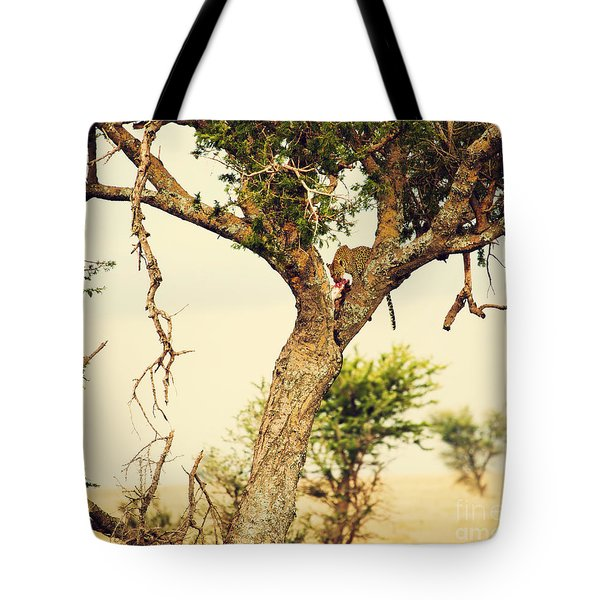 Leopard Eating His Victim On A Tree In Tanzania Tote Bag by Michal Bednarek