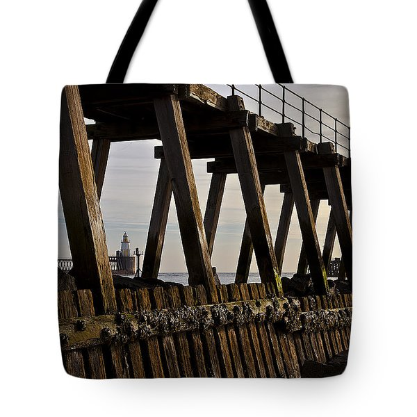 Lighthouse Through The Wooden Pier Tote Bag by Jim Jones