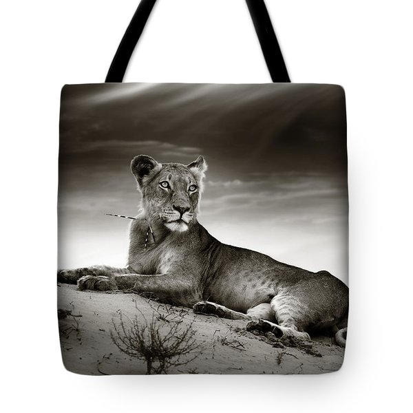 Lioness on desert dune Tote Bag by Johan Swanepoel