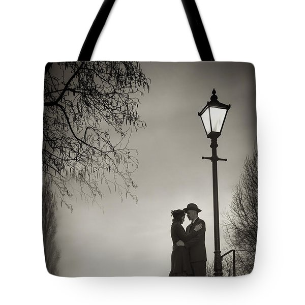 Lovers Say Goodbye Under A Streetlamp Tote Bag by Lee Avison
