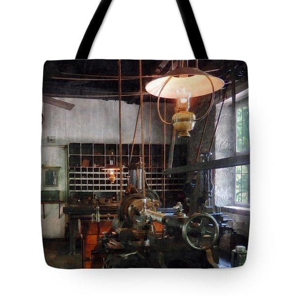 Machine Shop With Lantern Tote Bag by Susan Savad