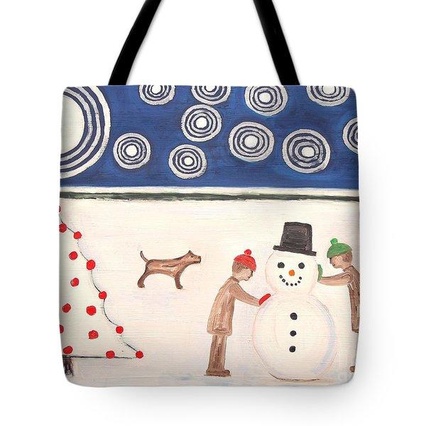 MAKING A SNOWMAN AT CHRISTMAS Tote Bag by Patrick J Murphy