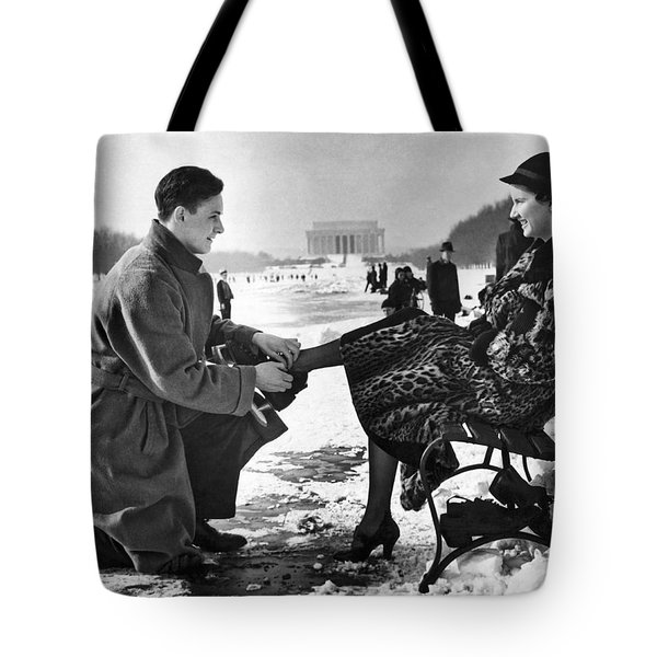 Man Lends A Helping Hand To Put On Skates Tote Bag by Underwood Archives