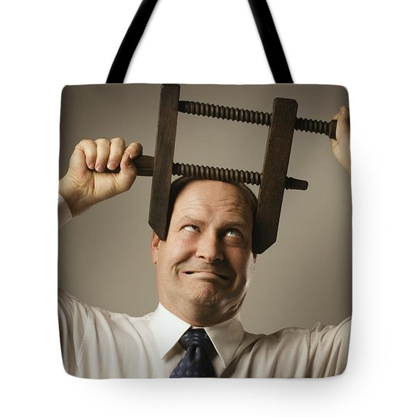 Man With Head In Vice Tote Bag by Don Hammond