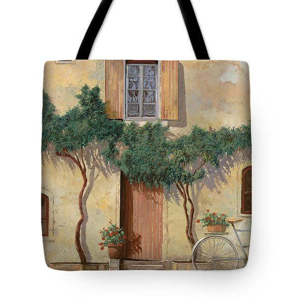 Mezza Bicicletta Sul Muro Tote Bag by Guido Borelli