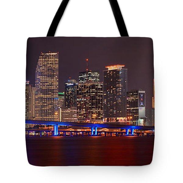 Miami Skyline At Night Panorama Color Tote Bag by Jon Holiday