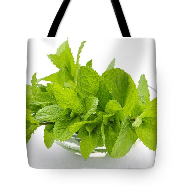 Mint sprigs in bowl Tote Bag by Elena Elisseeva