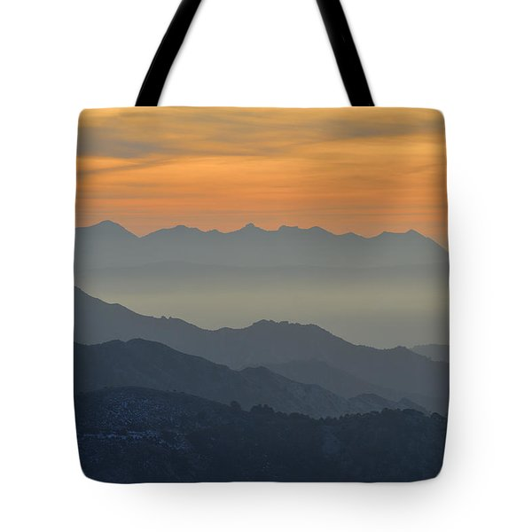 Mists In The Mountains At Sunset Tote Bag by Guido Montanes Castillo