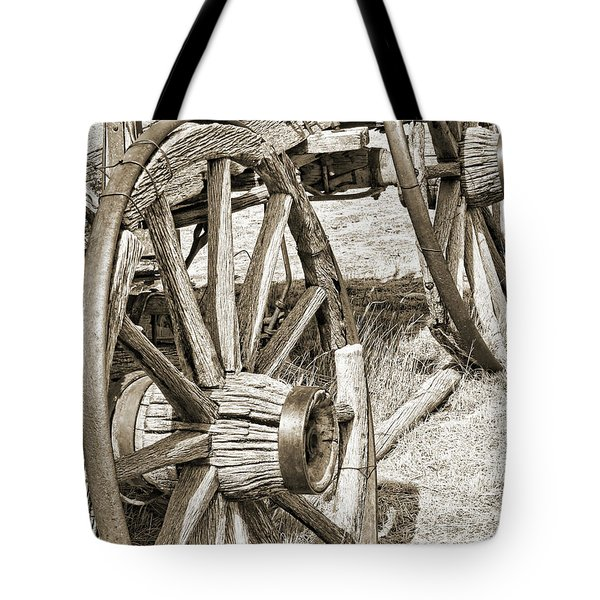 Montana Old Wagon Wheels in Sepia Tote Bag by Jennie Marie Schell