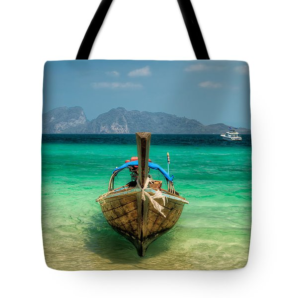 Moored Longboat Tote Bag by Adrian Evans