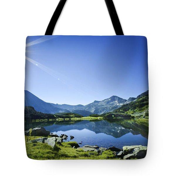 Muratov Lake Against Blue Sky Tote Bag by Evgeny Kuklev
