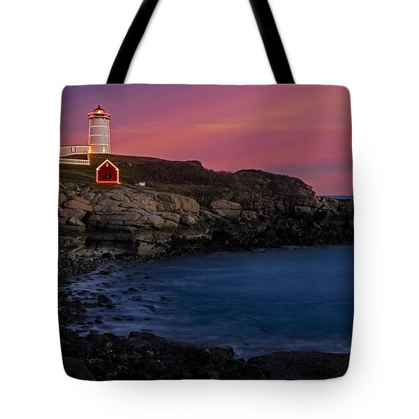 Nubble Lighthouse At Sunset Tote Bag by Susan Candelario
