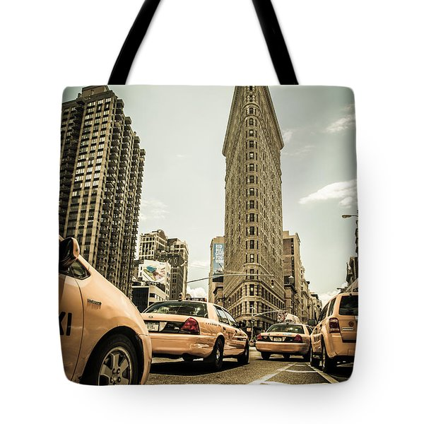 Nyc Yellow Cabs At The Flat Iron Building - V1 Tote Bag by Hannes Cmarits