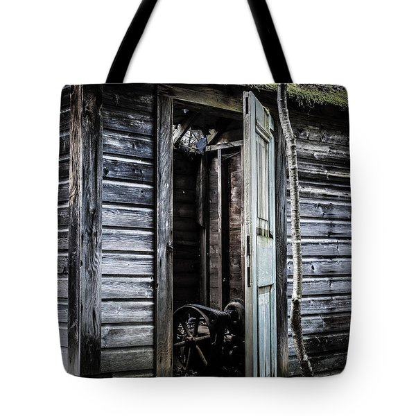 Old Abandoned Well House With Door Ajar Tote Bag by Edward Fielding