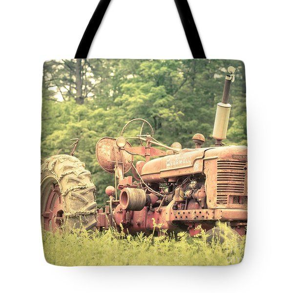 Old Farmall Tractor at Sunrise Tote Bag by Edward Fielding