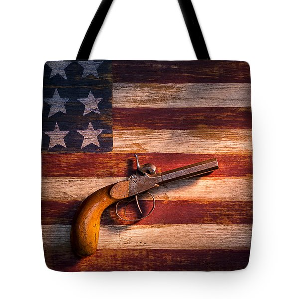 Old gun on folk art flag Tote Bag by Garry Gay