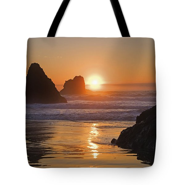 Orange Sunset Behind Offshore Rocks Tote Bag by Philippe Widling