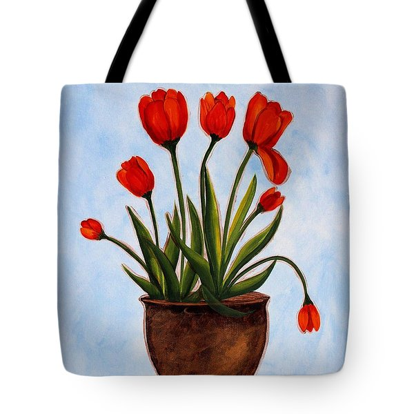 Orange Tulips On A Blue Buffet Tote Bag by Barbara Griffin