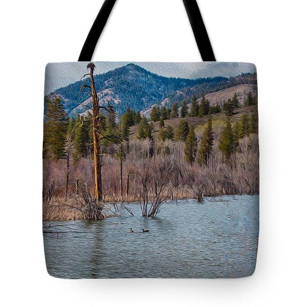 Osprey Nest In A Beaver Pond Tote Bag by Omaste Witkowski