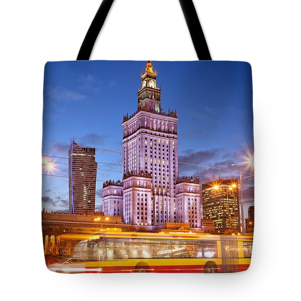 Palace of Culture and Science in Warsaw at Dusk Tote Bag by Artur Bogacki