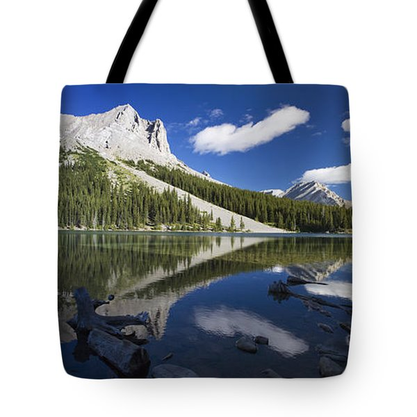 Panorama Of A Mountains Reflecting On A Tote Bag by Michael Interisano