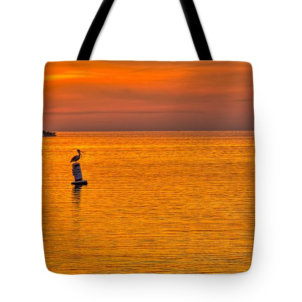 Pelican On A Buoy Tote Bag by Marvin Spates