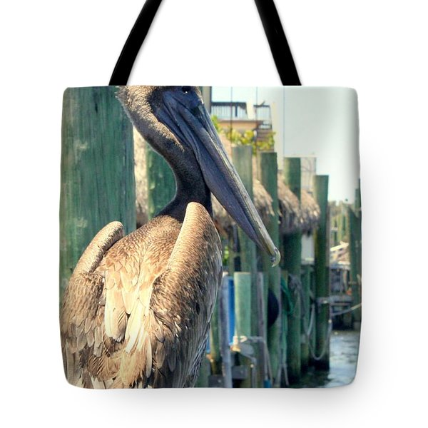 Pelican On A Post Tote Bag by Dorothy Menera