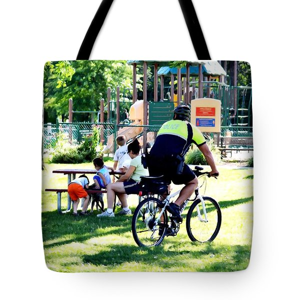 Police Officer Rides A Bicycle Tote Bag by Lanjee Chee
