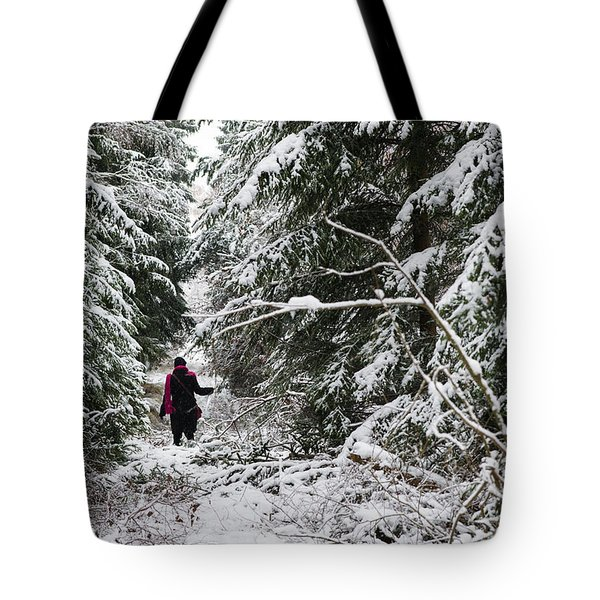 Protective forest in winter with snow covered conifer trees Tote Bag by Matthias Hauser