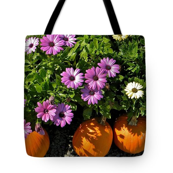 Purple Daisies And A Touch Of Orange Tote Bag by Jean Goodwin Brooks
