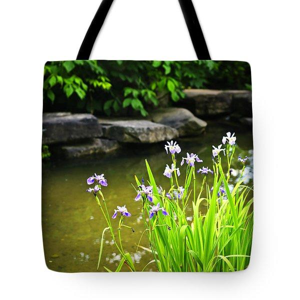 Purple irises in pond Tote Bag by Elena Elisseeva