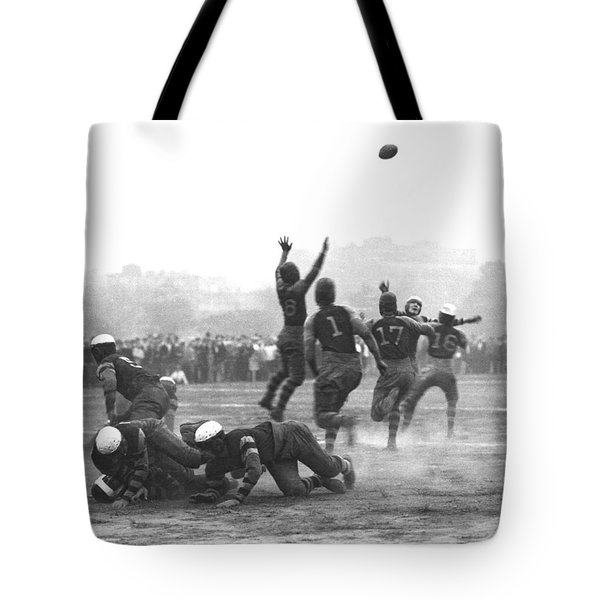 Quarterback Throwing Football Tote Bag by Underwood Archives