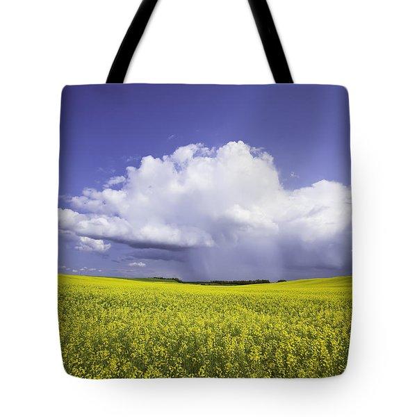 Rainstorm Over Canola Field Crop Tote Bag by Ken Gillespie
