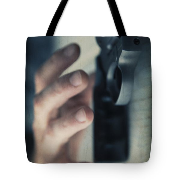 Reaching For A Gun Tote Bag by Edward Fielding