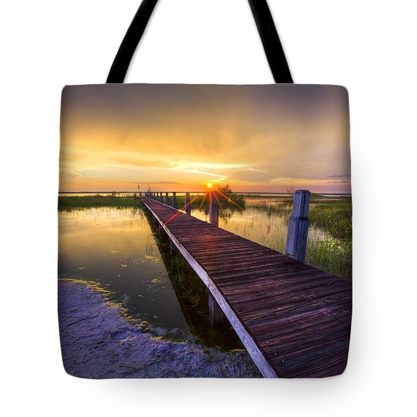 Reaching Into Sunset Tote Bag by Debra and Dave Vanderlaan