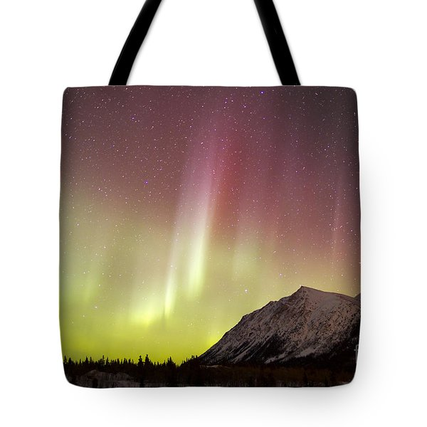 Red Aurora Borealis Over Carcross Tote Bag by Joseph Bradley