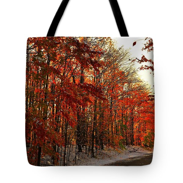 Red Autumn Road In Snow Tote Bag by Terri Gostola