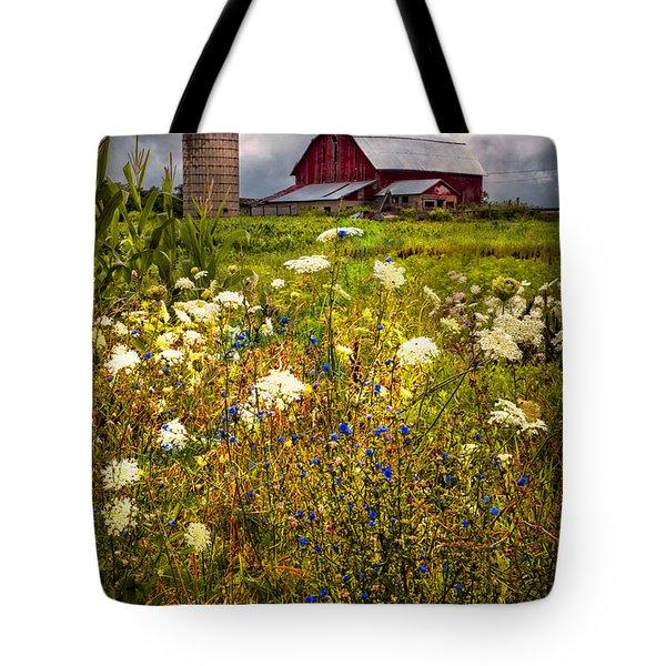 Red Barns In The Wildflowers Tote Bag by Debra and Dave Vanderlaan