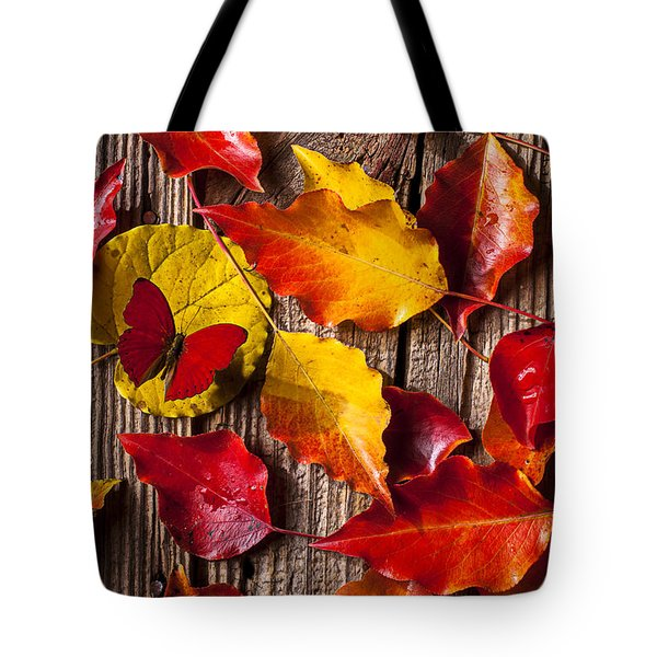 red butterfly in autumn leaves Tote Bag by Garry Gay